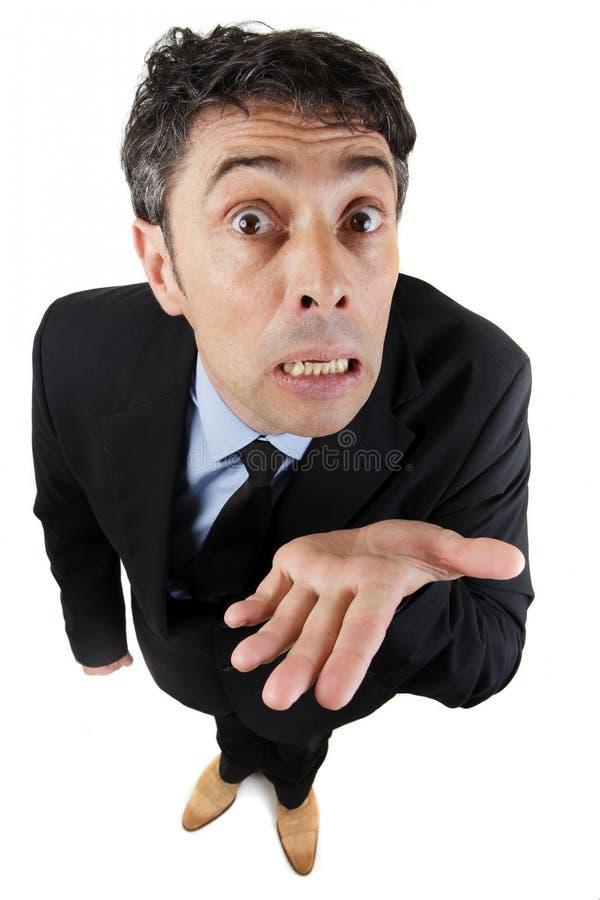 Fattig man som tigger eller pläderar som är hans arkivfoto