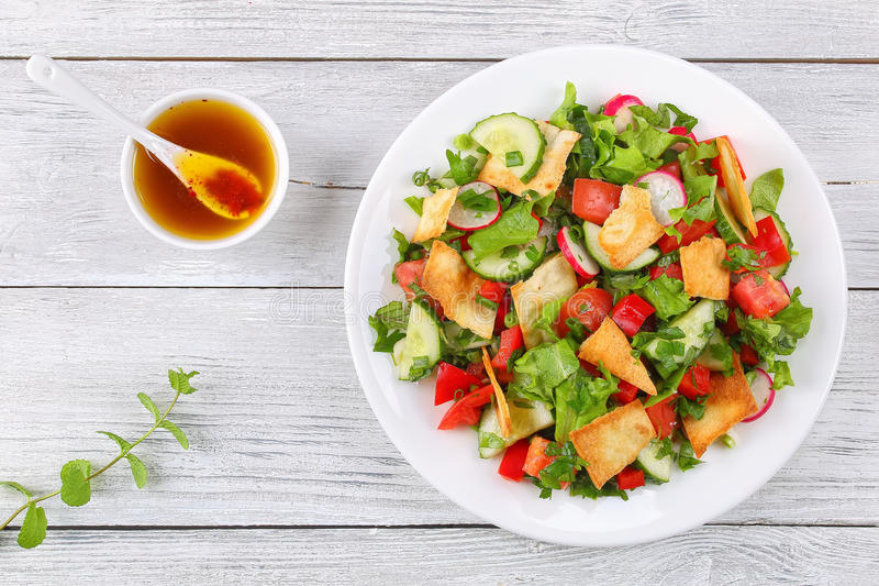 Delicious Fattoush Or Bread Salad With Pita Croutons Fresh Vegetables And Herbs On White Plate Wooden Table Sumac Olive Oil Gravy Easy