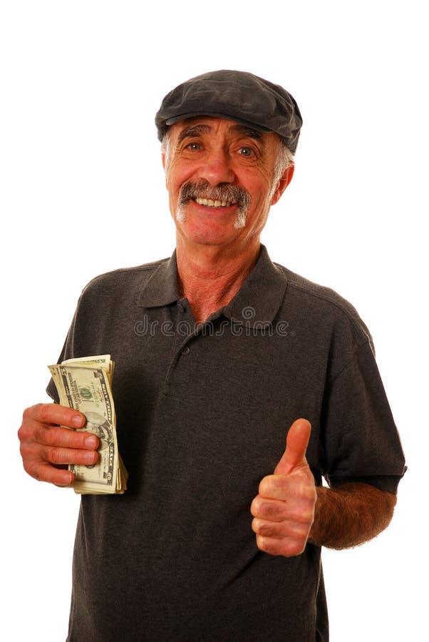 Fatture del dollaro della holding dell'uomo fotografie stock