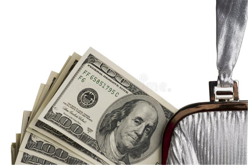 Fatture del dollaro in un sacchetto delle donne. immagini stock