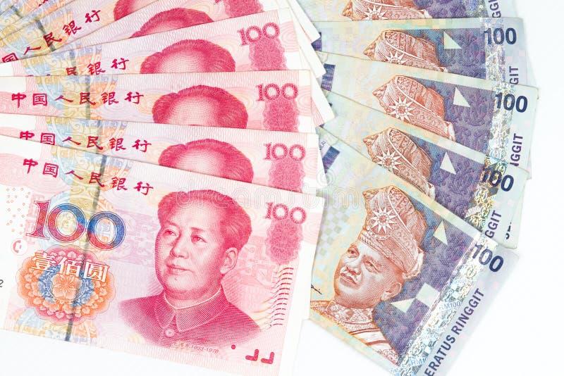 Fatture della Malesia e della Cina nel fondo bianco immagini stock libere da diritti