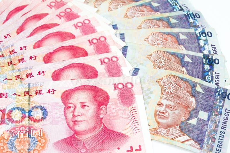 Fatture della Malesia e della Cina nel fondo bianco immagini stock