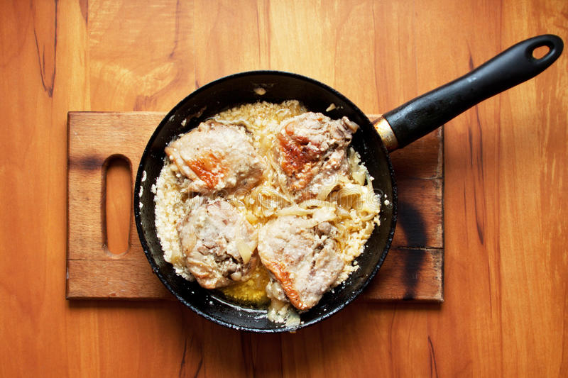 Fatty Meat Fried With Onions Stock Photo