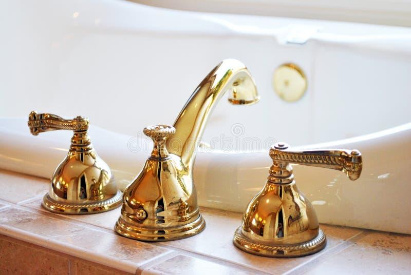 Faucet золота стоковое изображение