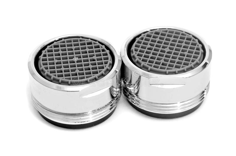 Faucet aerators. Some faucet aerators on a white background royalty free stock image