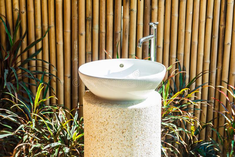 Faucet in bathroom with bamboo wall stock photos
