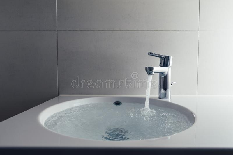 Faucet With Flowing Water In Wash Sink Stock Photo - Image of mono ...