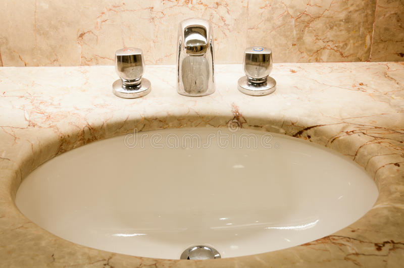 Download Faucet With Handles And White Sink Stock Photo - Image: 21608504