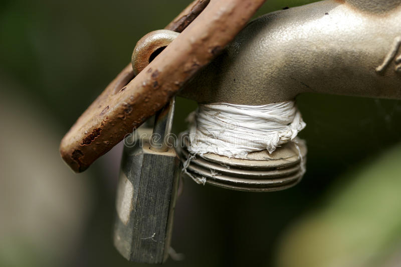 Faucet with a lock stock image. Image of padlock, case - 51723281