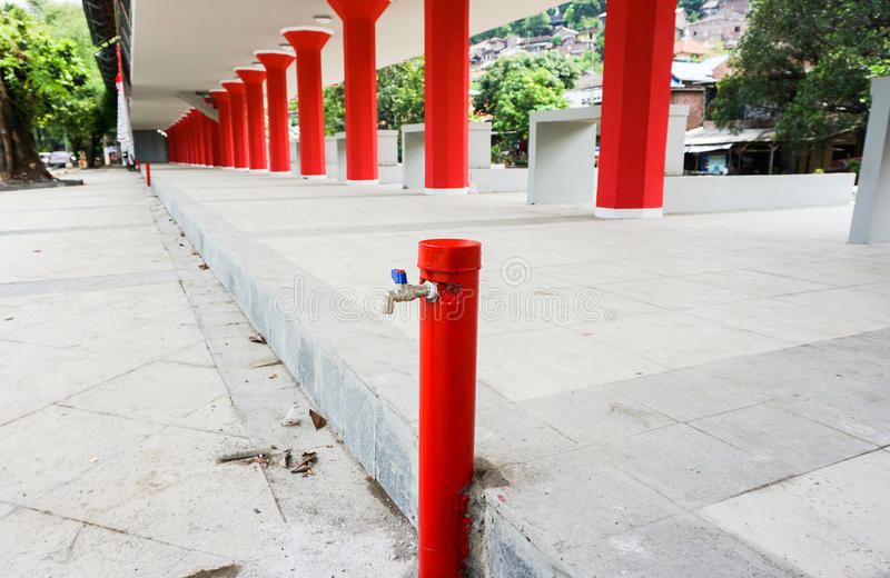Faucet and red pillars photo taken in Semarang Indonesia. Java stock photography