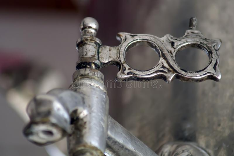 The faucet of the samovar with silver patina through which water is poured stock images