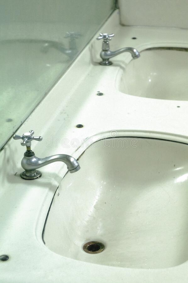 Faucets on sink royalty free stock images
