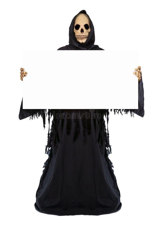 Faucheuse tenant un panneau d'affichage vide images libres de droits