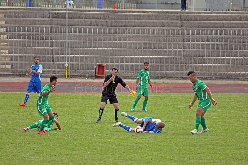 Football fault. A fault in the deaf football world cup match italy vs iraq played at eboli in italy stock image