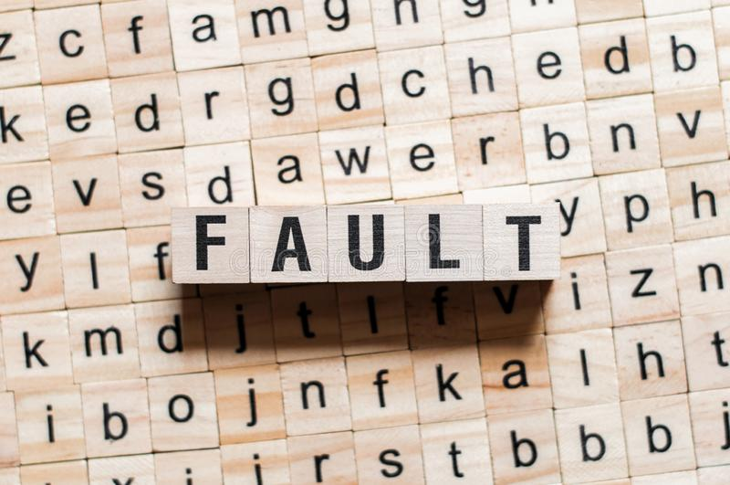 Fault word concept. On cubes stock photos