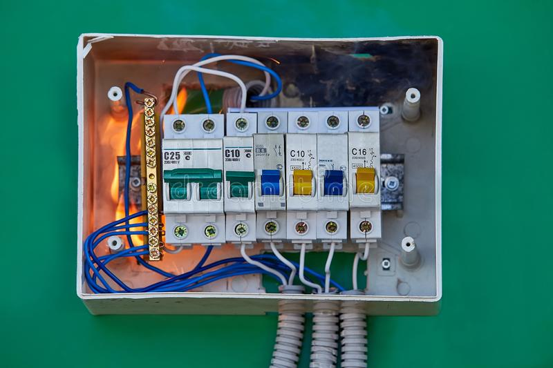 Faulty electrical panel may cause a fire. Severe electrical arcing in panel box led to a fire in the apartment. Bad electrical wiring systems became the cause stock images