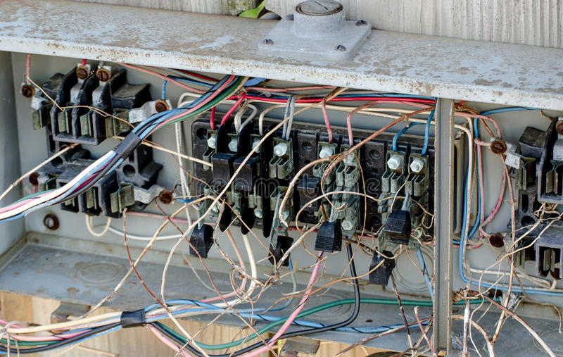 Electrical Hazard wiring. Faulty or poor electrical work can cost thousands in damage from potential fires. This connection box is a fire loss waiting to happen royalty free stock photos