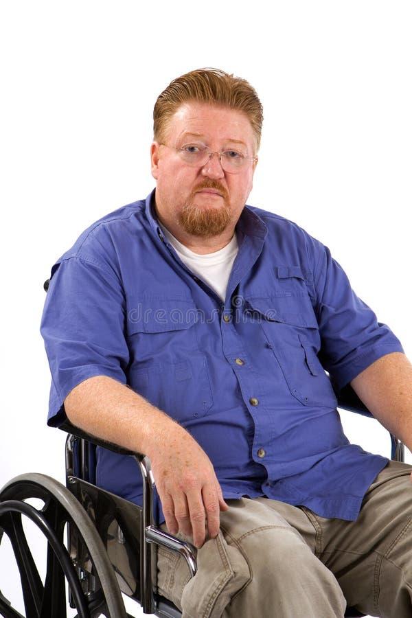 Fauteuil roulant d'homme triste image libre de droits