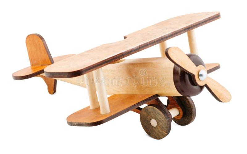 Faux avion fait de bois d'isolement sur le fond blanc image stock