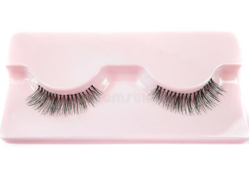 Faux fake artificial eyelashes eye lashes natural hair set pair. Pair of faux fake artificial eyelashes eye lashes natural hair plastic set stock images