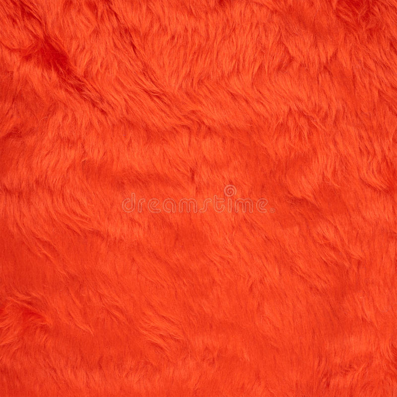 Faux fur texture background. Colored red faux fur texture background fragment royalty free stock photo