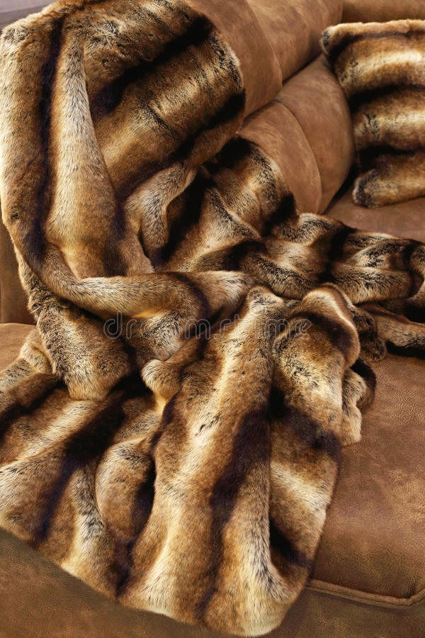 Faux Fur Throw. Blanket for Cold Winter at Sofa royalty free stock images
