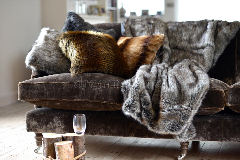Faux fur. Throws and cushions room interior stock photos