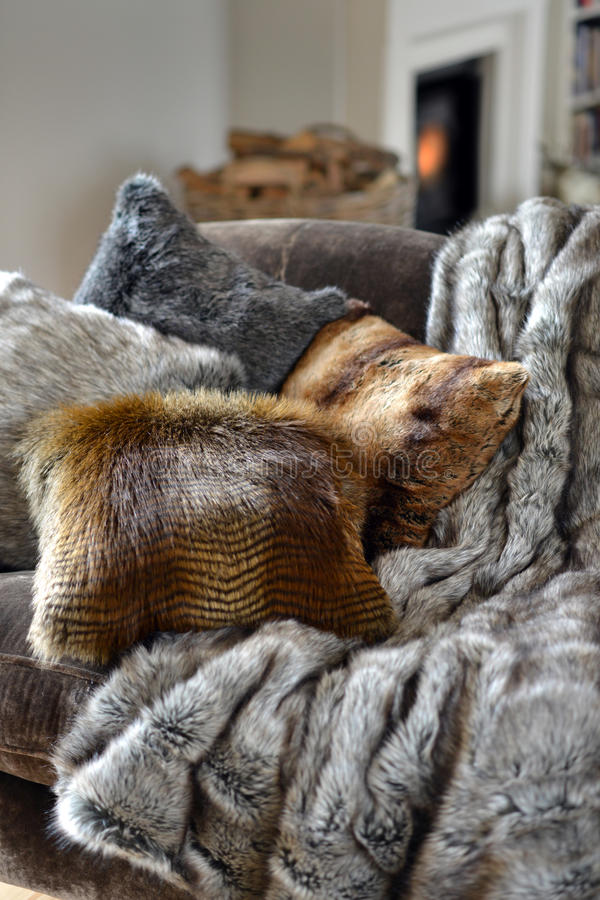 Faux fur. Throws and cushions room interior stock photography