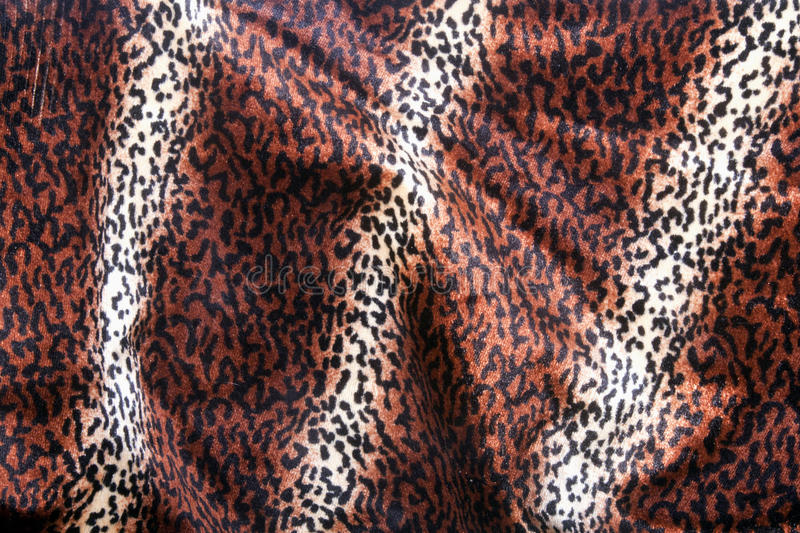 Faux Leopard Print Pattern on Furry Fabric royalty free stock photos