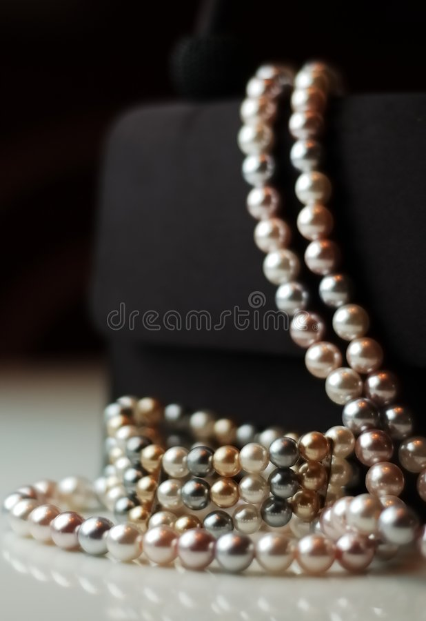 Faux Pearls on Evening Bag royalty free stock image
