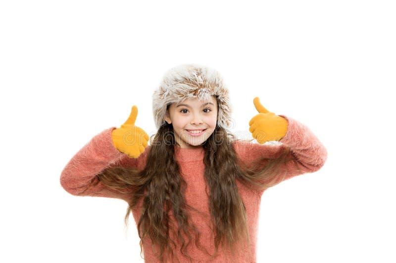 Faux-Pelzentwicklung Playful fashionista Kinderlanges Haar Weiches Fell, das Weichheit genießt Soft Care Konzept Mädchenlanghaark stockfotografie