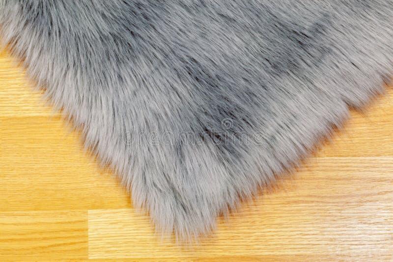 Faux rug on floor. In room stock photos