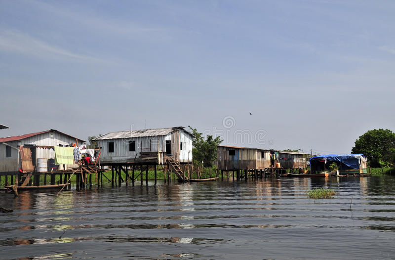 Favela. A favela view with its typical houses, here in the bank of the rio Amazonas - amazon river stock photo