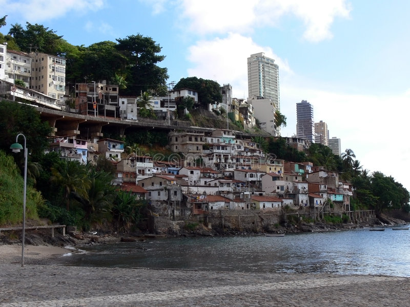 Favela. Bahia de todos os santos - Brazilian Favela poverty with a great landscape stock image