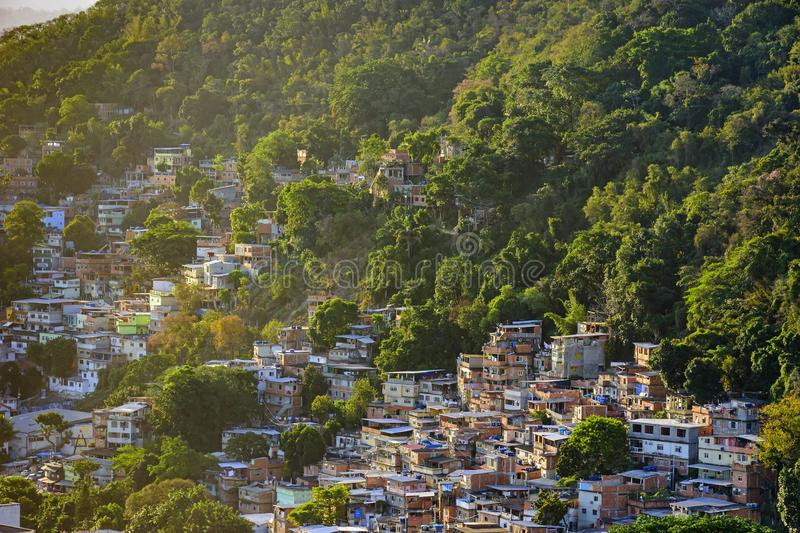 Favela between the vegetation. Of the slopes of the hills in Copacabana in Rio de Janeiro stock photos