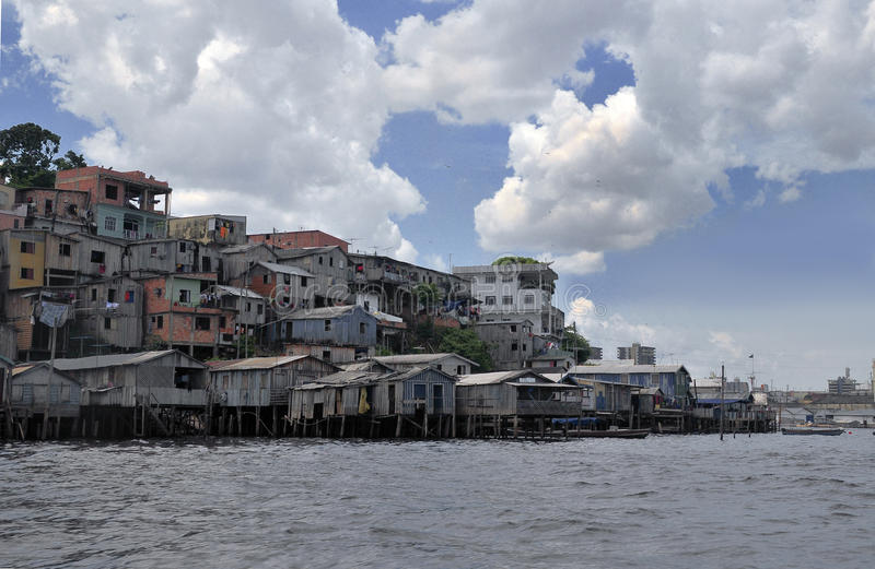 Favela. A favela view with its typical houses, here in the bank of the rio Amazonas - amazon river royalty free stock images