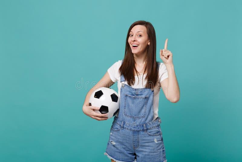 Favorit- lag för upphetsad service för kvinnafotbollsfanjubel upp med pekfingret för håll för fotbollboll upp med stor ny idé arkivbild