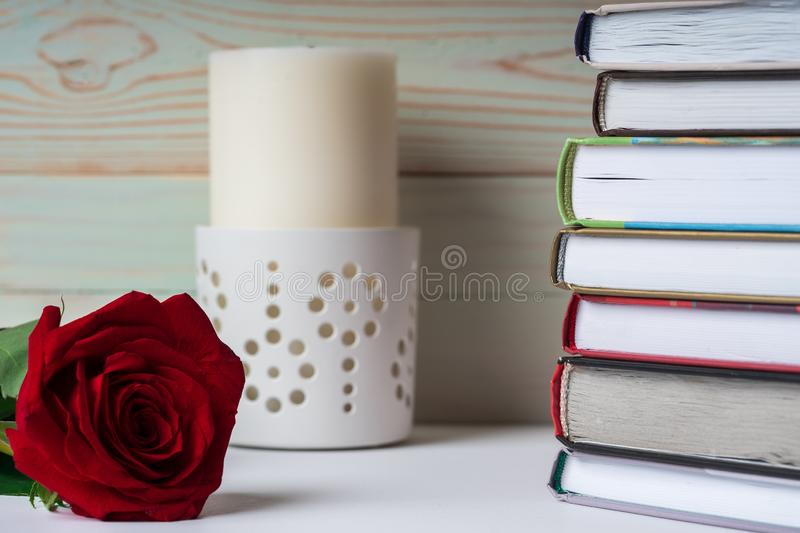 A stack of books in anticipation of the evening reading. Favorite books are stacked in anticipation of reading royalty free stock images