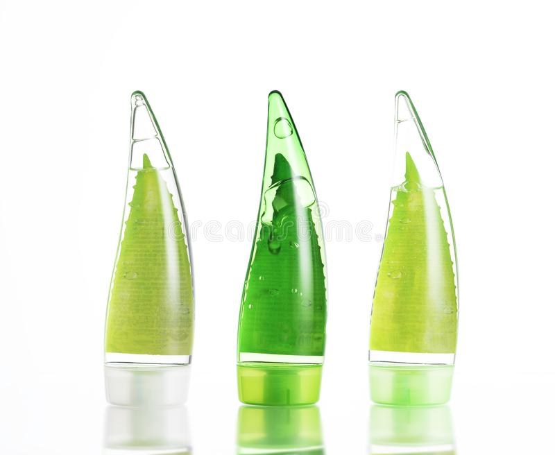three green bottles of makeup. eco-friendly gel, shampoo and cream on white background. isolate stock image