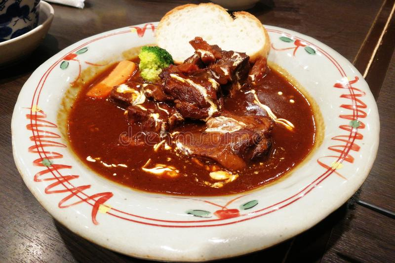 Beef curry with rice. Favorite menu of the beef curry rice under the candle light stock images