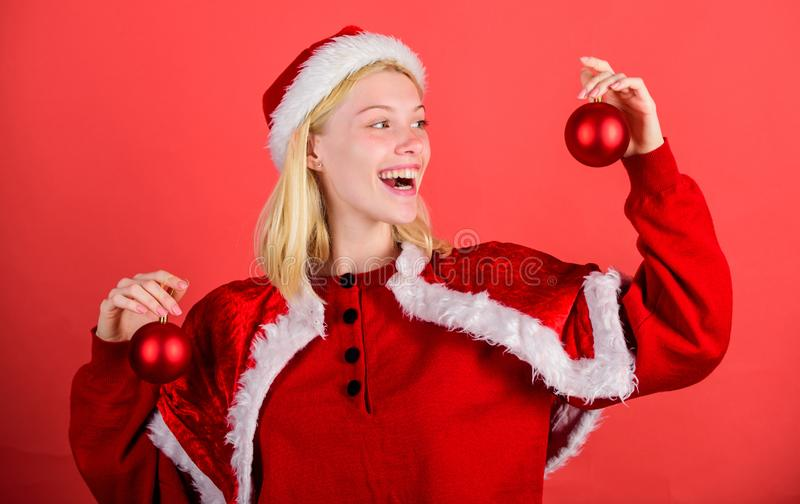 Favorite time year christmas. Christmas fun. Girl happy wear santa costume celebrate christmas hold ball decor red. Background. Christmas preparation concept stock photography