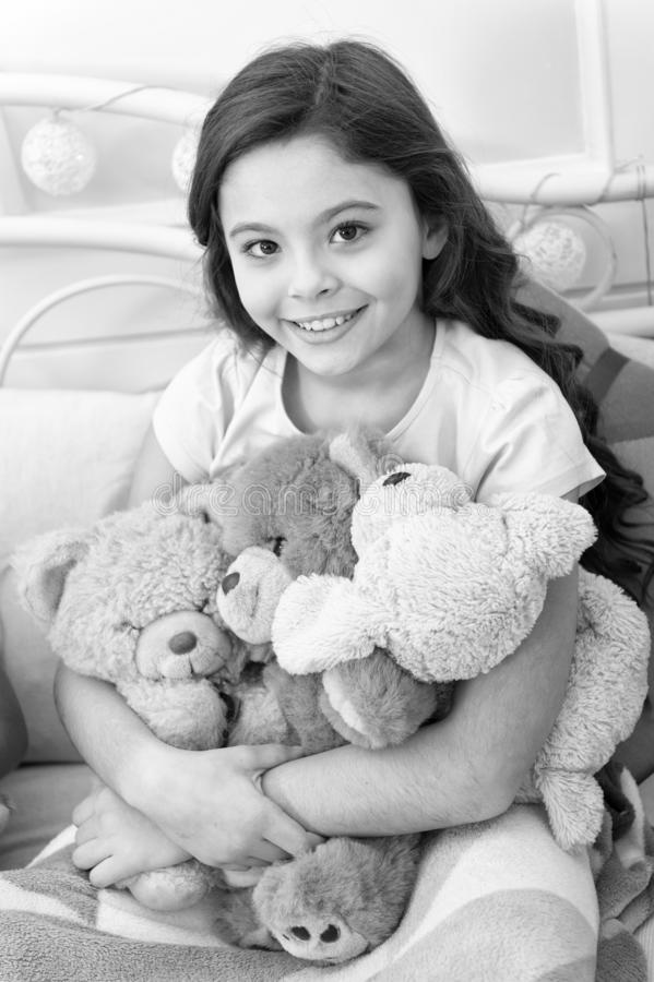 Favorite toys. Christmas gift concept. Teddy bear improve psychological wellbeing. Child small girl playful hold teddy royalty free stock images