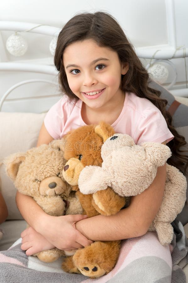 Favorite toys. Christmas gift concept. Teddy bear improve psychological wellbeing. Child small girl playful hold teddy stock image