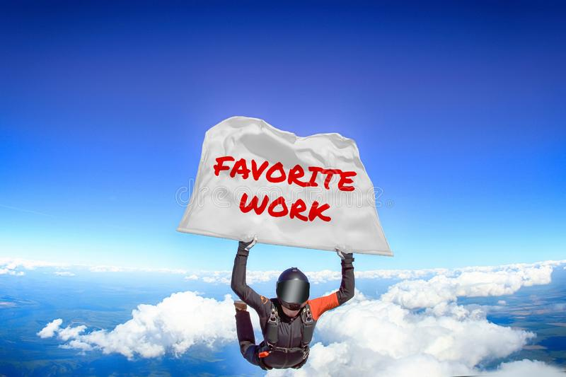Favorite work. Flag in skydiving. People in free fall.Teampleat skydiver. Extreme sport. Favorite work. Men in parachute equipment. Skydiving sport. Extreme royalty free stock image