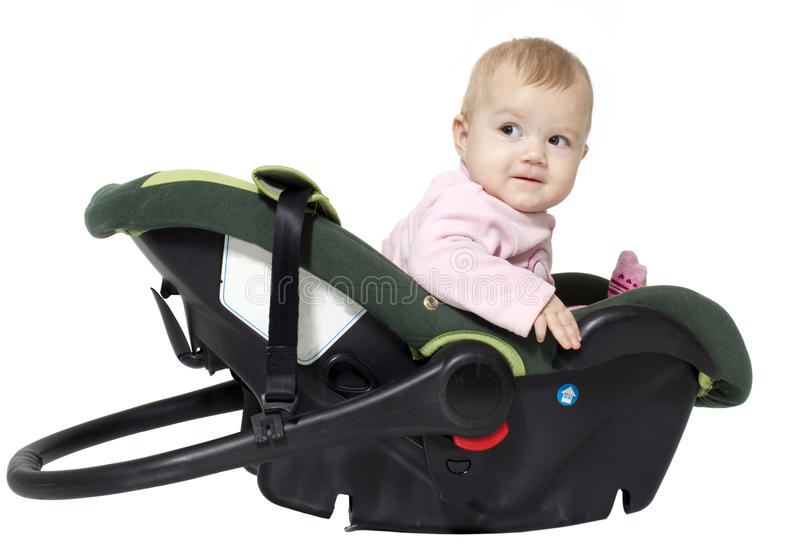In a favourite cradle. The little girl sits in an automobile cradle royalty free stock image