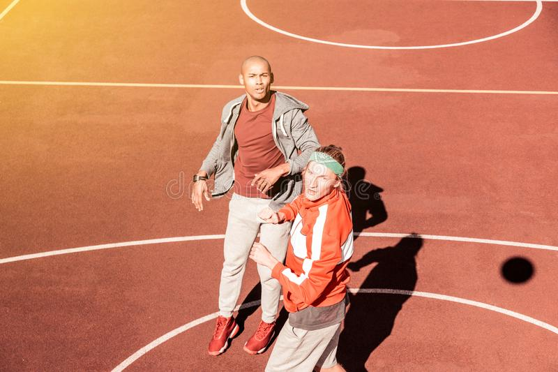 Nice sportive young men playing together basketball royalty free stock photos