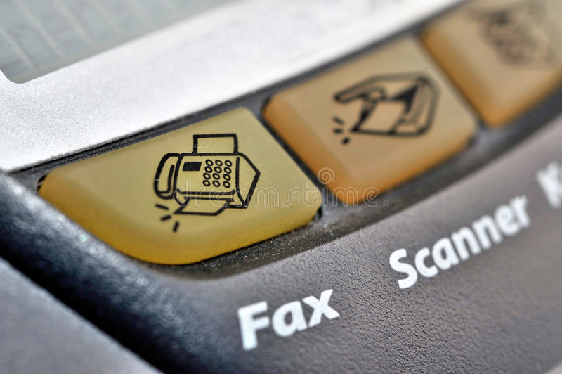 Fax Button. A closeup view of the Fax button on a multipurpose device royalty free stock image