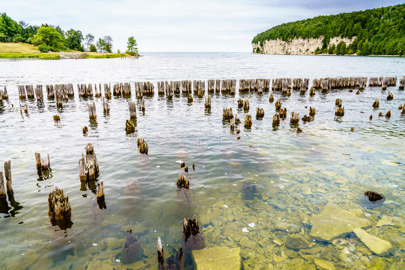 Fayette State Park shoreline. Remnants of docks in Fayette Historic Townsite in Michigan stock photo