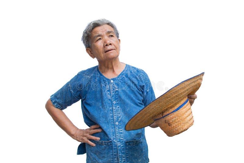 Fazendeiro asiático idoso da mulher da ansiedade em um branco foto de stock royalty free