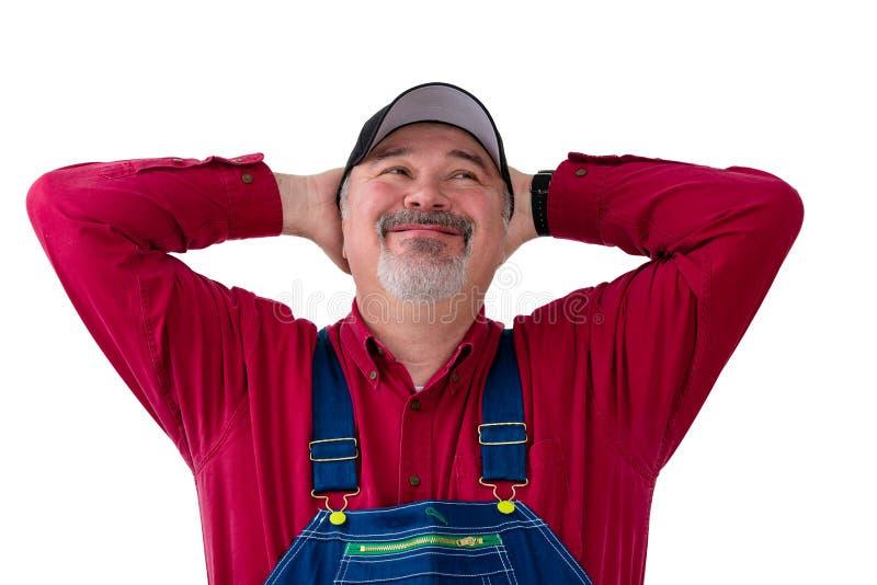 Fazendeiro ou trabalhador com um sorriso feliz grande imagens de stock royalty free